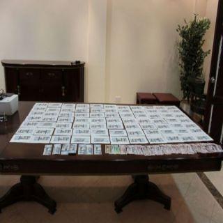 بالصور -الإطاحة بأربعة متهمين متورطين بتزييف العملات النقدية بـ #القصيم