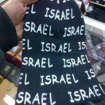 """""""حائل"""" ضبط محل تجاري يبيع قبعات مكتوب """"إسرائيل"""""""