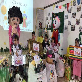 أطفال عسير المعاقين يشاركون انبثاق العلمفي اليوم العالمي للإعاقة