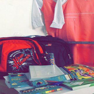 عون النسائية ببريدة توزع الحقيبة المدرسية على مستفيدها