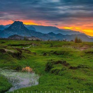 عدسة مُصور تُبرز جمال وادي البرداني يظهر في الصورة جبل بركوك بثلوث المنظر