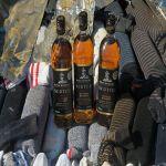 احباط تهريب 3 آلاف زجاجة خمر في «الميناء الجاف»